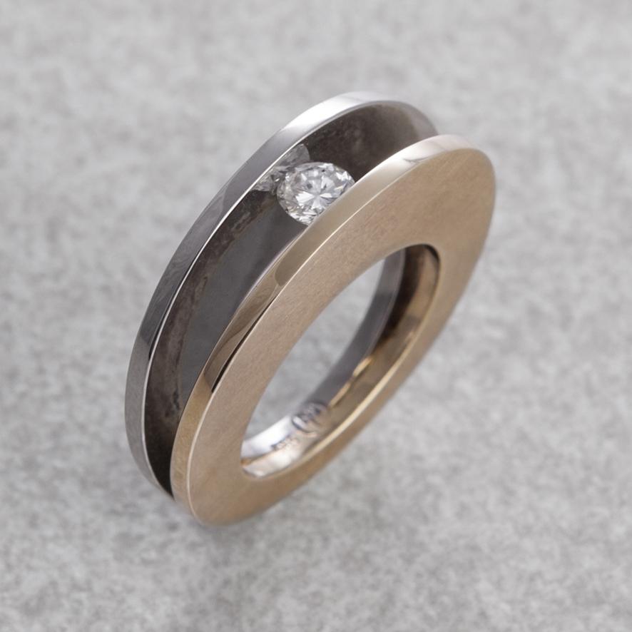 Ring bicolor mit Brillant